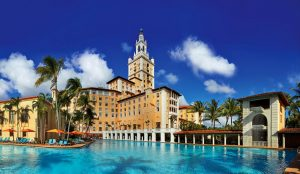waterfront view of the biltmore hotel in coral gables